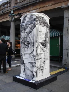 "Cosmo Sarson's artistic ""Peekaboo"" design in Covent Garden. One was compelled to peek through the spy hole ..."