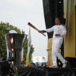 Daley Thompson lights the Olympic cauldron