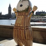Big Ben Wenlock near the London Eye, sporting some fetching Victorian-Gothic pyjamas (Ooo, I just want to give that lovely little tummy a big squeeze!)