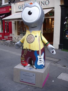 How on earth does Wenlock play on that mouth-organ without a mouth? Busker Wenlock in Covent Garden