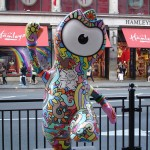 Groovy Wenlock doing his best Austin Powers impression along Regent Street as Queen's Guard Wenlock looks wistfully on