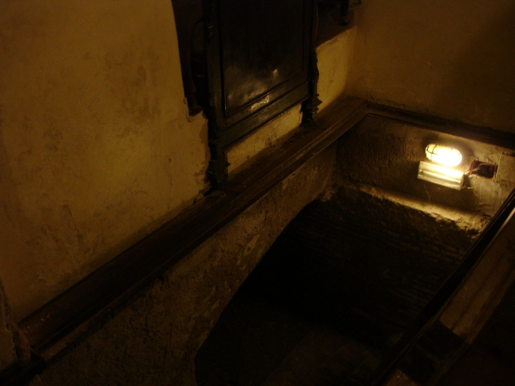 The bed (top centre) disappeared into the wall behind it revealing a trap door to the basement below