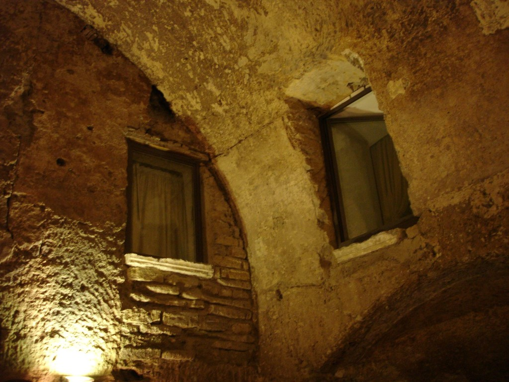 Inside the old cobbler's workshop showing fine examples of Roman brickwork. The windows belong to the B&B next door. No doubt the price for one night with breakfast in one of these rooms shot up on learning that it wasn't just a cobbler's workshop guests could peer into