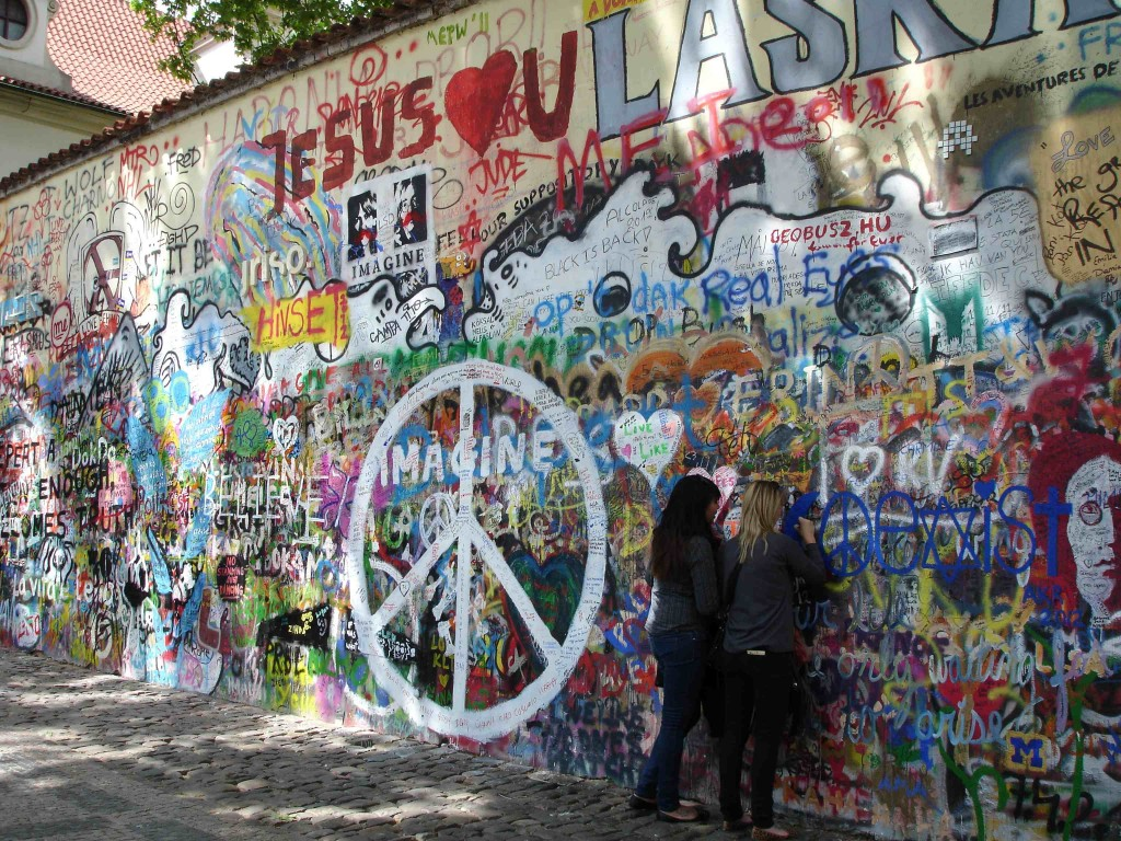 These two girls were adding how they 'heart' Justin Bieber to the John Lennon wall. Well, I guess it is an expression of love