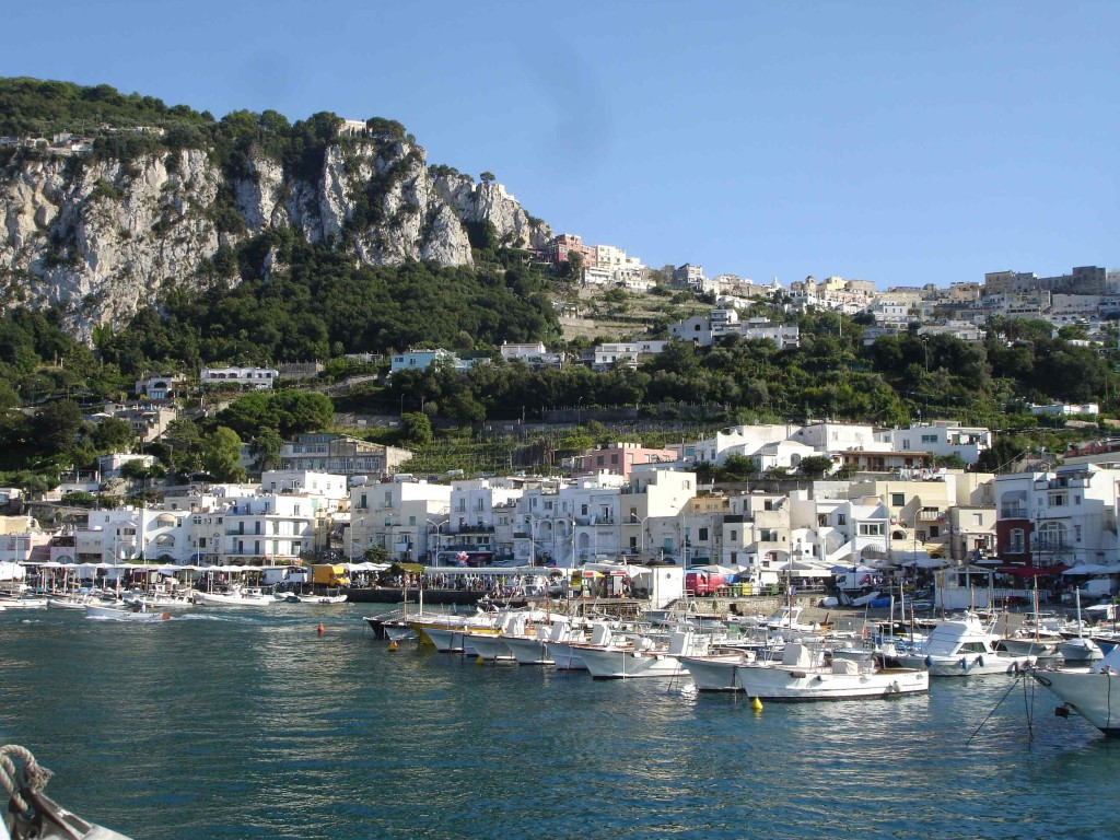 Arriving into the busy Marina Grande (Capri Harbour), overlooked by stylish Capri Town on top of the hill. How does my hair look?