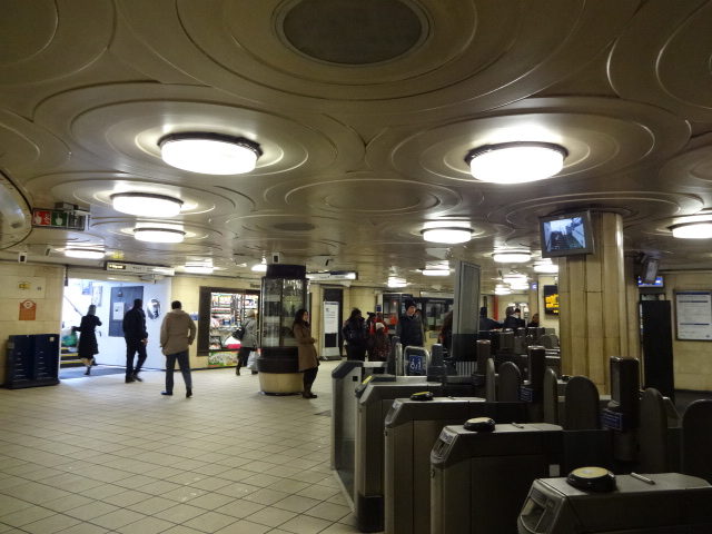 The booking hall as it looks today. In 1996 Holden's original circular ceiling pattern & round light fittings design were faithfully replicated to replace the hideous strip lights some idiot put in during the 1970s