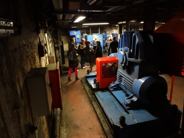 Inside the escalator engine room. The engines were huge and surprisingly colourful with major parts painted in a delightful blue and red (in keeping with the Underground's distinct and iconic palette)