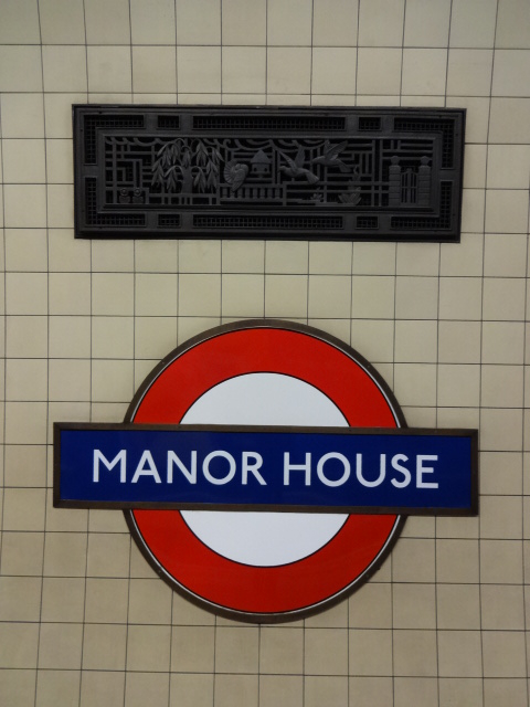 One of Harold Stabler's original solid brass ventilation covers on the Westbound platform at Manor House Tube station