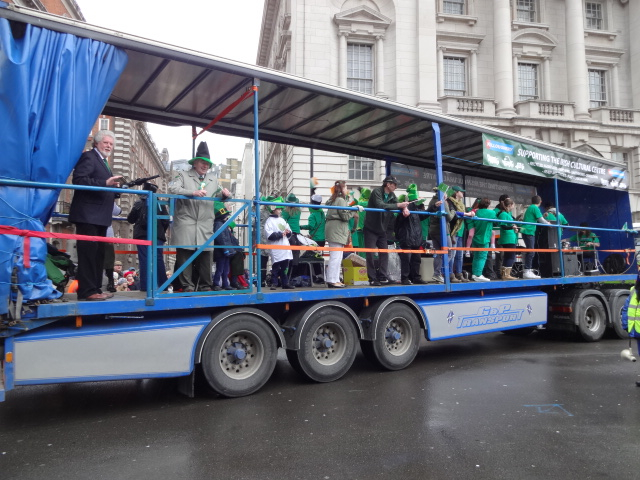 The parade included a float full of traditional Irish people ...