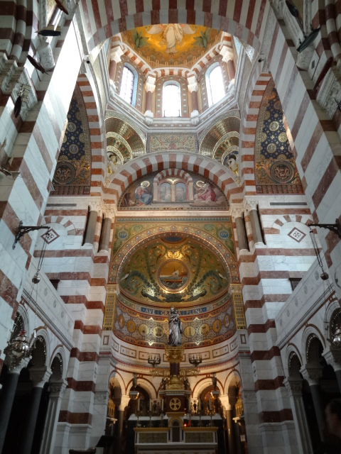 The beautiful interior of the Notre Dame de la Garde adorned with marbles, mosaics, murals ....