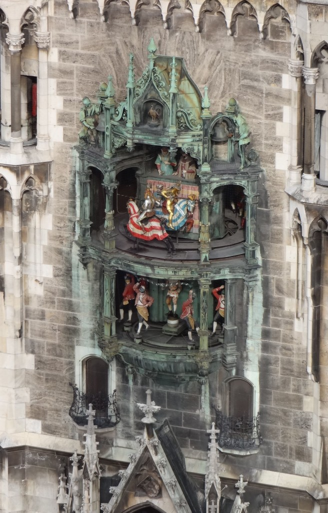 The Rathaus-Glockenspiel in motion from 12.05pm, seen (with zoom lens) from the top of St Peterskirche. Straining one's eyes from this vantage point to watch it is arguably more comfortable than straining one's neck from the street level below, as most tourists tend to do