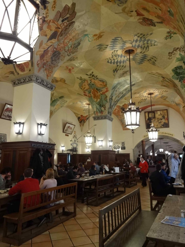The warm, inviting interior of the Hofbrauhaus where the cavernous ceilings do little to reduce the volume of the revellers ...