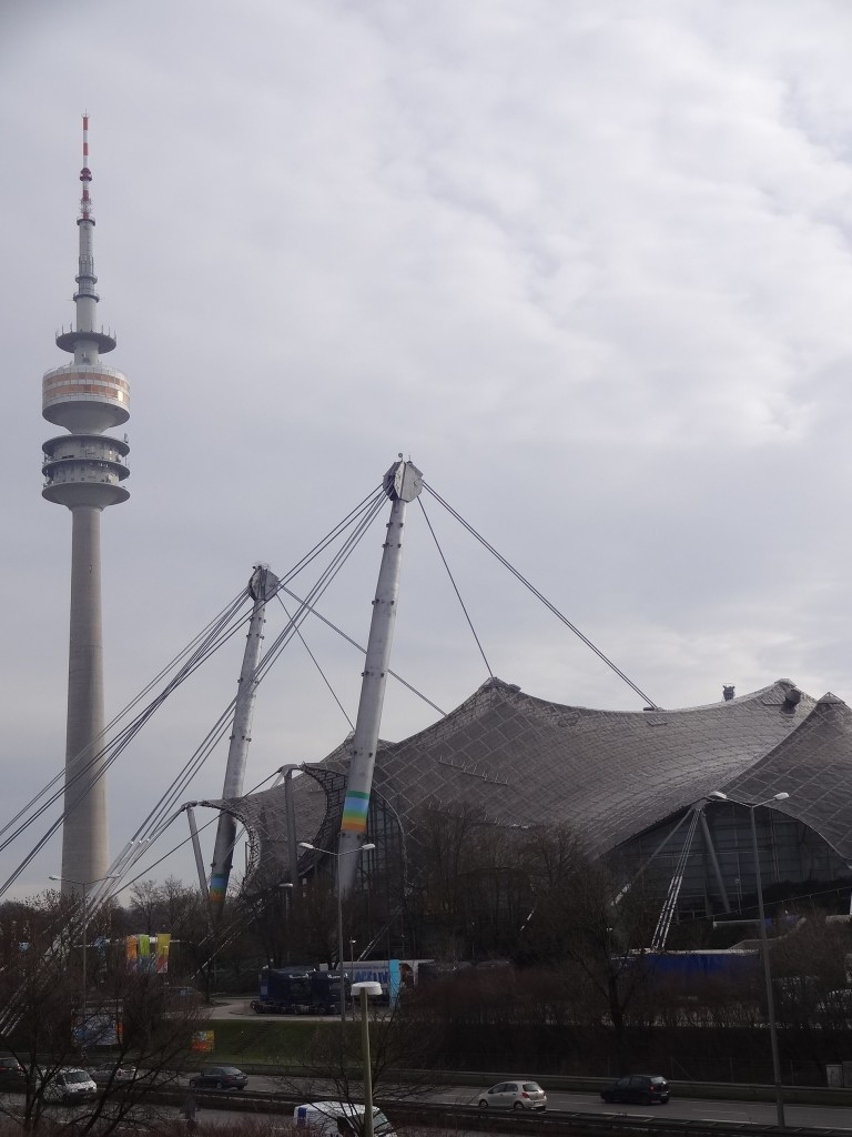 The cobweb style roof of the Munich Olympic stadium and the Olympiaturm (Olympic Tower)