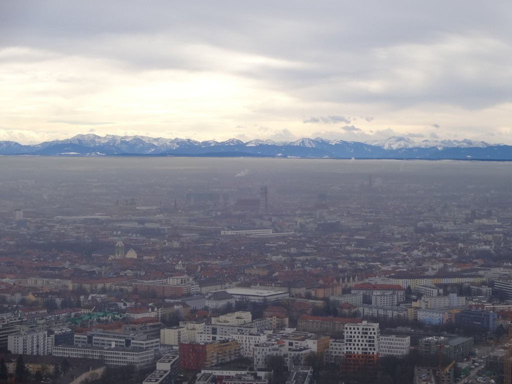 The crystal clear Alps and the city of Munich under a veil of mist, seen from the top of the Olympiaturm