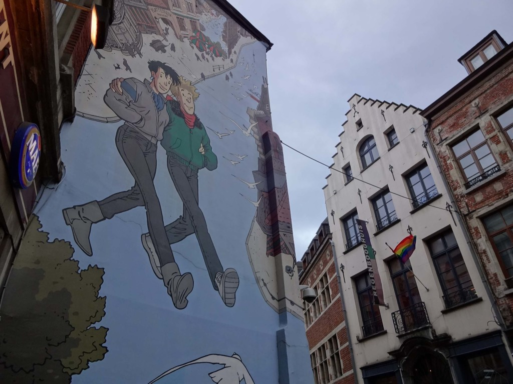 "There is some controversy behind this mural: originally it was thought to depict a gay couple as it's located in the city's gay nightclub district. But in 1999, the mural was repainted and locals argued that the refreshed figure on the left looked more feminine than before, with the appearance of longer hair, an earring, larger breasts and a name: ""Catherine"""