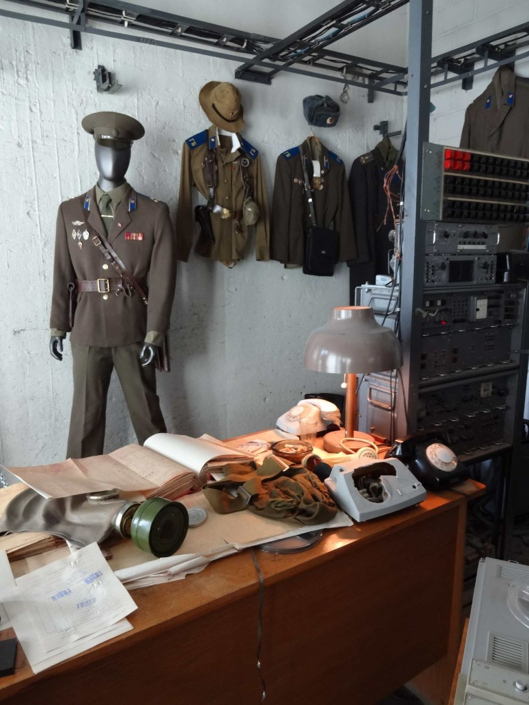 Authentic KGB uniforms in addition to the actual furnishings and equipment found in the now defunct KGB operations room