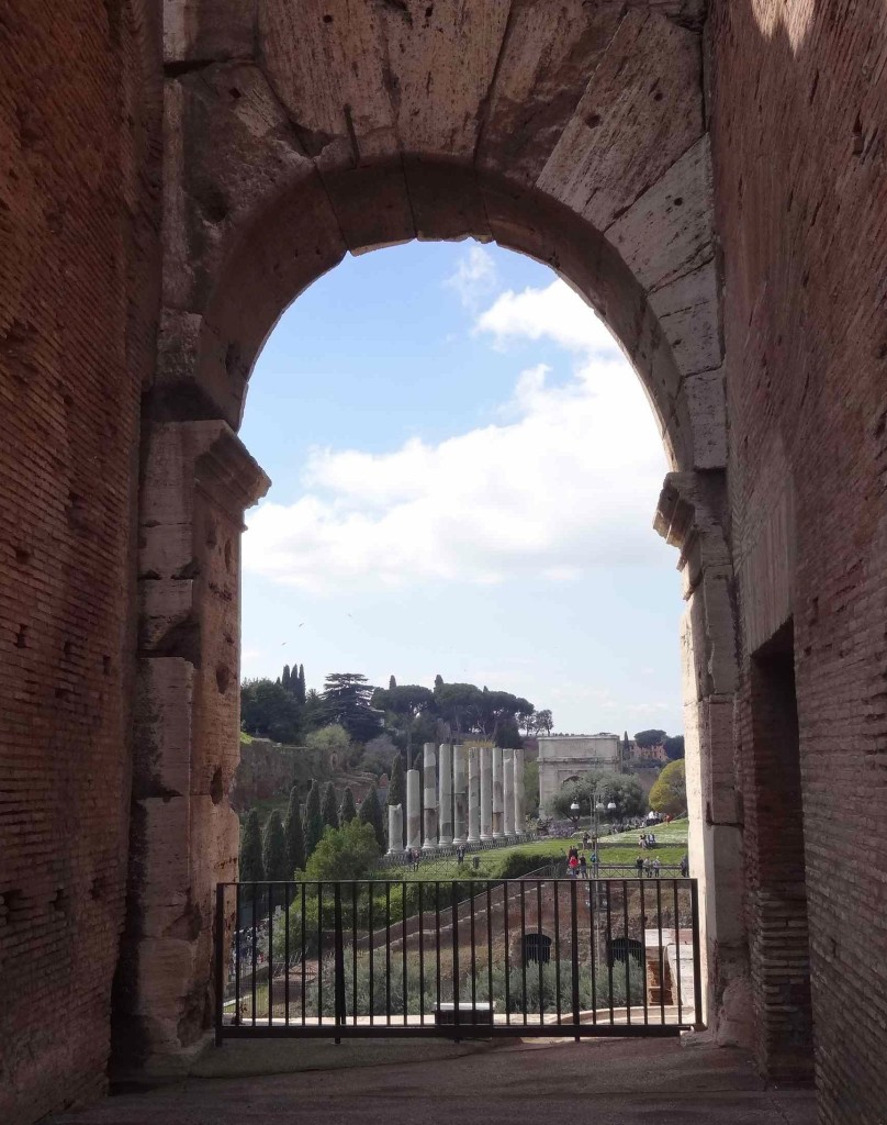 An arched window looking out over to the Roman Forum beyond