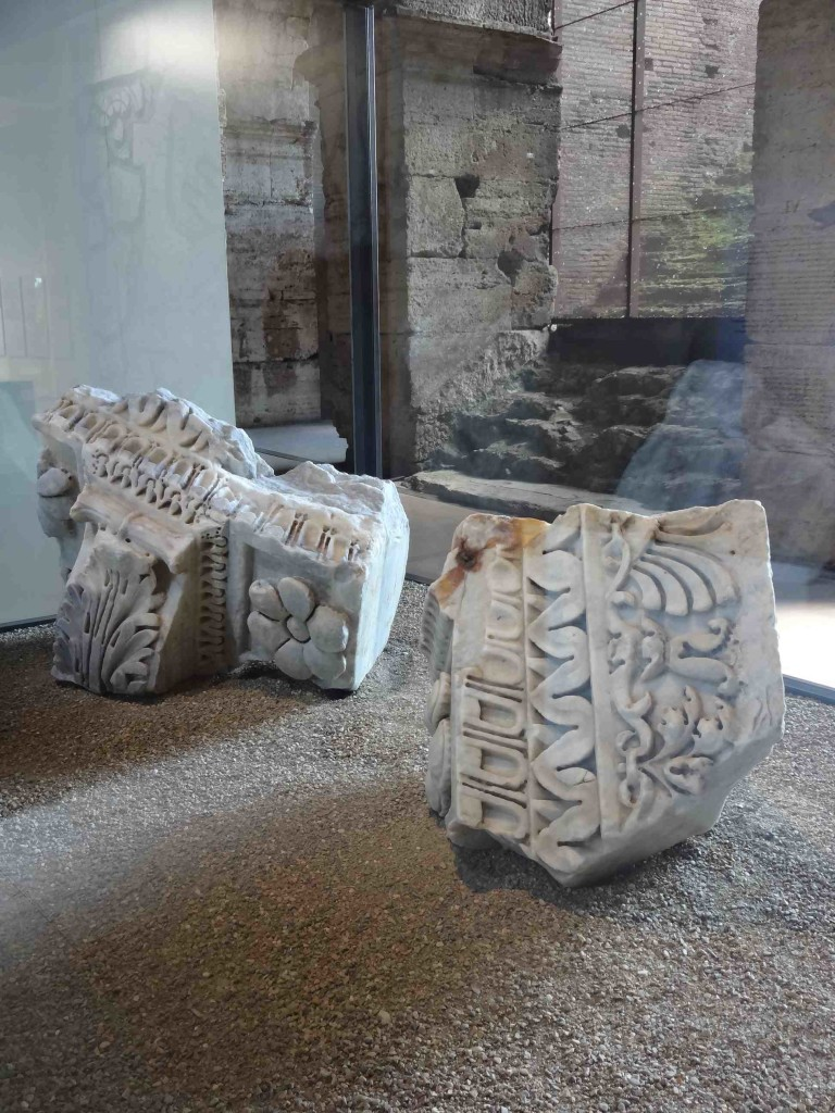 On the upper second tier there is a small area displaying some of the artefacts excavated from the site, including these fragments of coping from an aedicula ...