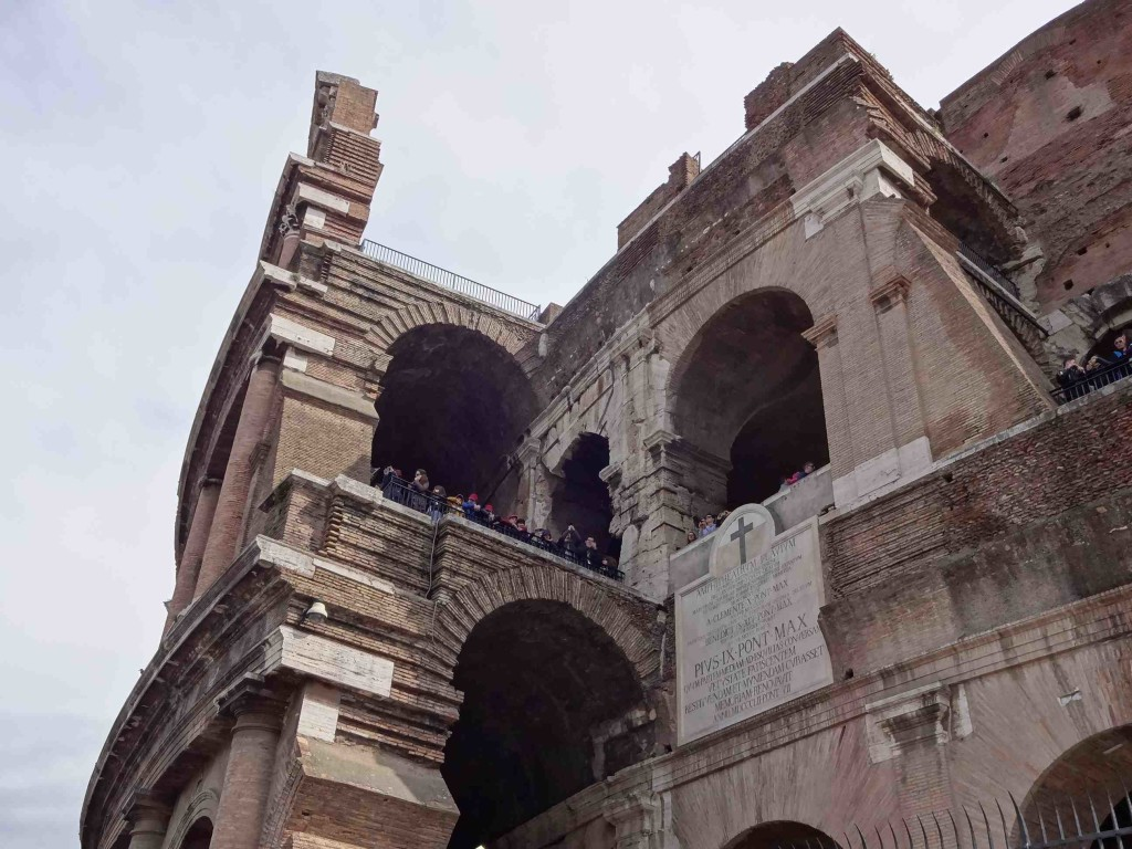 ... witnessing the equally large crowds within the Colosseum walls watching the ticket queue below ...