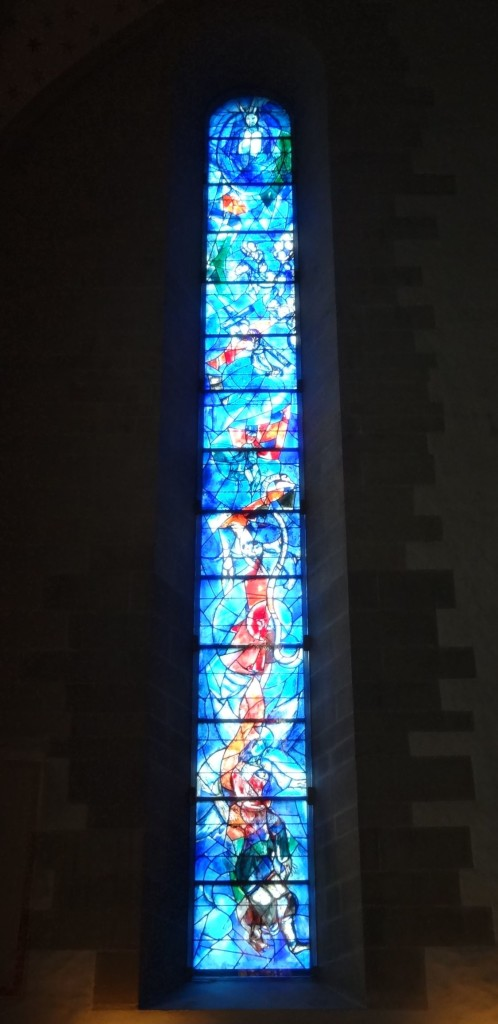 On the right wall, the 'Law' panel depicts Moses looking down at those not following the commandments ...