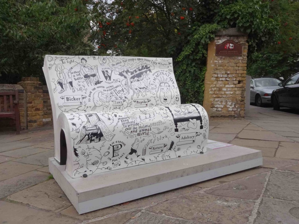 This very witty bookbench stands next to a plaque dedicated to Doug Mullins, Master Dairyman of the area