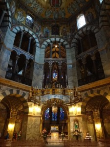 Inside Aachen Cathedral, and in its centre the splendid Carolingian Octagon built under Charlemagne's rule in honour of the Virgin Mary. It is also known as the Palace Chapel