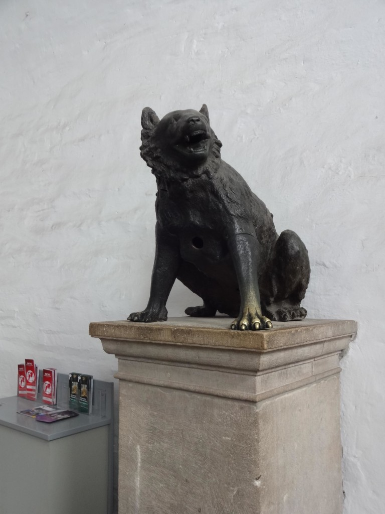 The 'She-Wolf' guarding the guide books by the entrance to Aachen Cathedral. The statue is in fact a female bear believed to date back to the second century