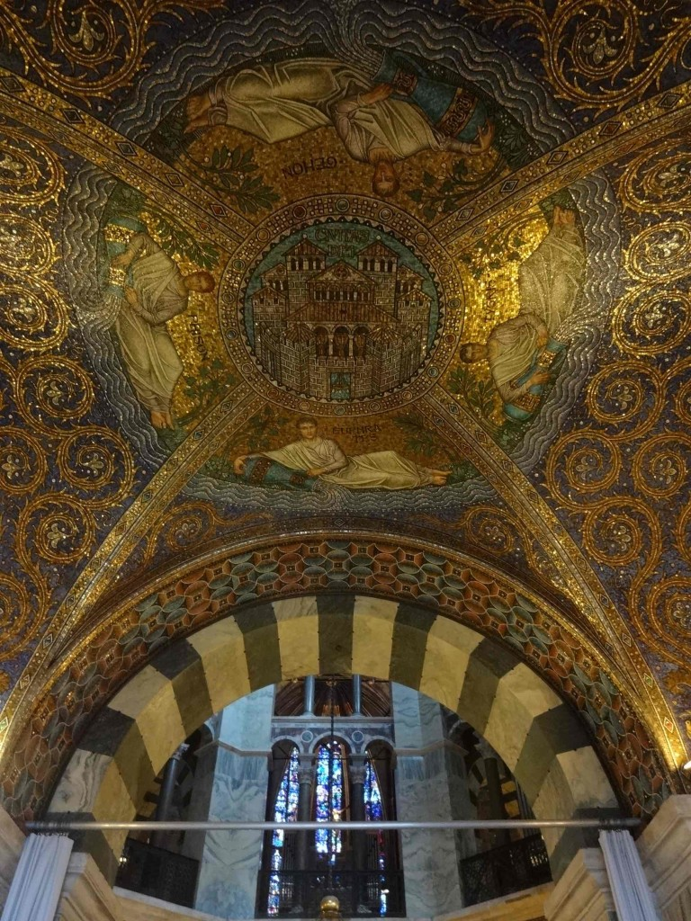 One of hundreds of religiously symbolic mosaics covering the interior of the ambulatory surrounding the central chapel