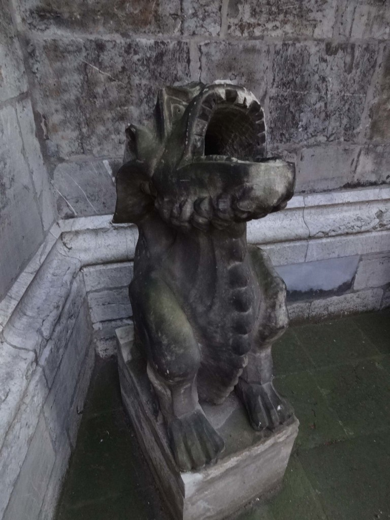 This gargoyle outside the cathedral looks like he is collecting rain water rather that spouting it out