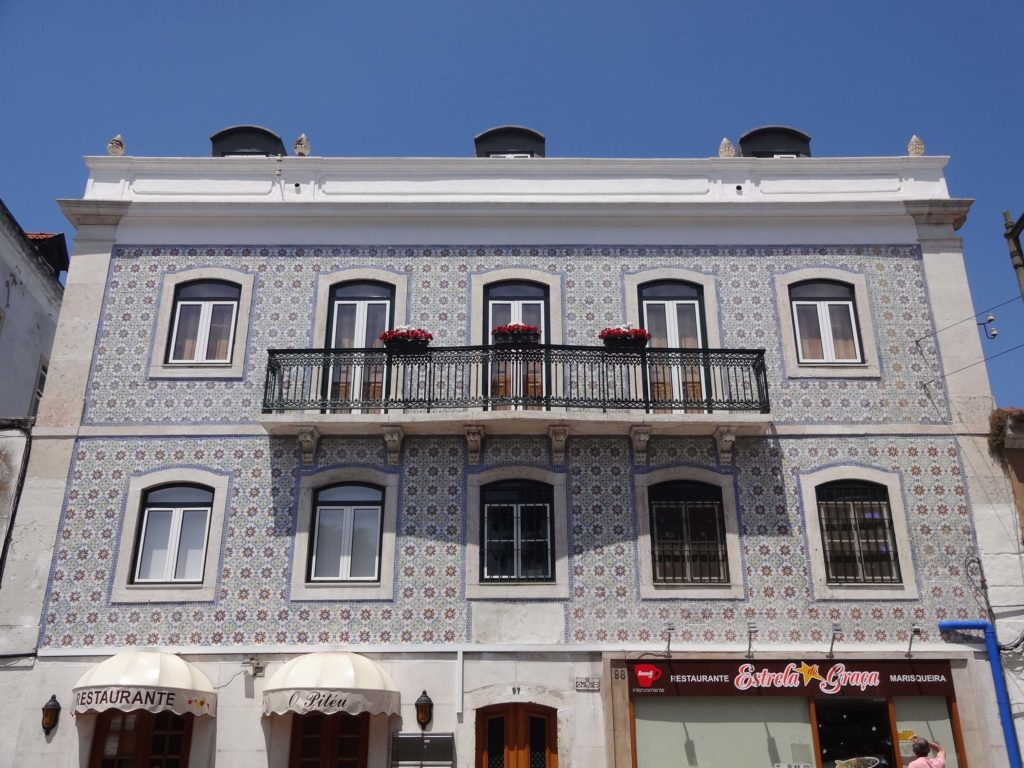 Alfama azulejos blue tiled covered low rise building