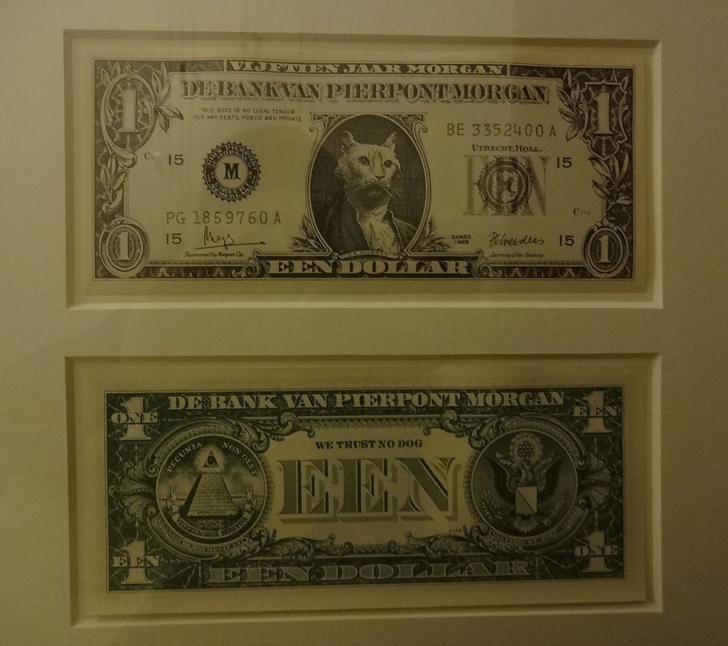 J.P. Morgan's priceless dollar bill by Aart Clerxkz incorporating the cat's earlier commissioned portrait