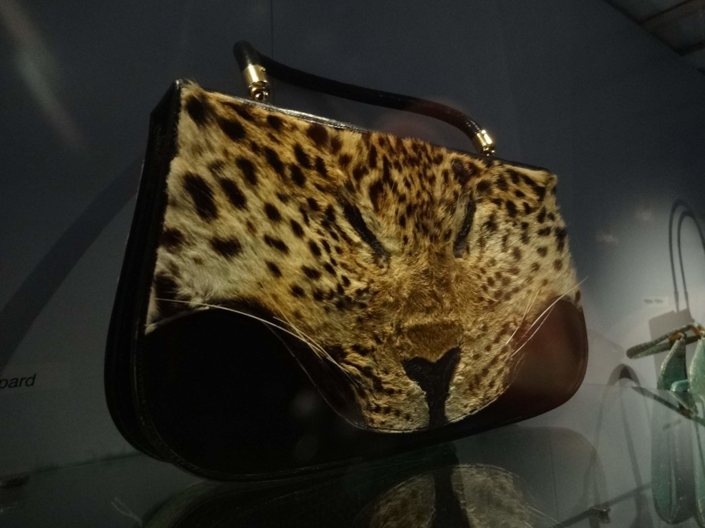 Giving new meaning to the phrase 'letting the cat out of the bag' (and yes, it's made from real leopard skin)