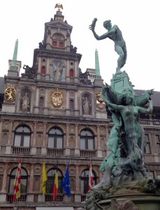 The figure of Silvius Brabo at the top of the fountain, seen in the process of throwing the severed hand of Antigoon into the river Scheldt and giving Antwerp its name. The only problem here is, the river is actually in the other direction, behind the Stadhuis