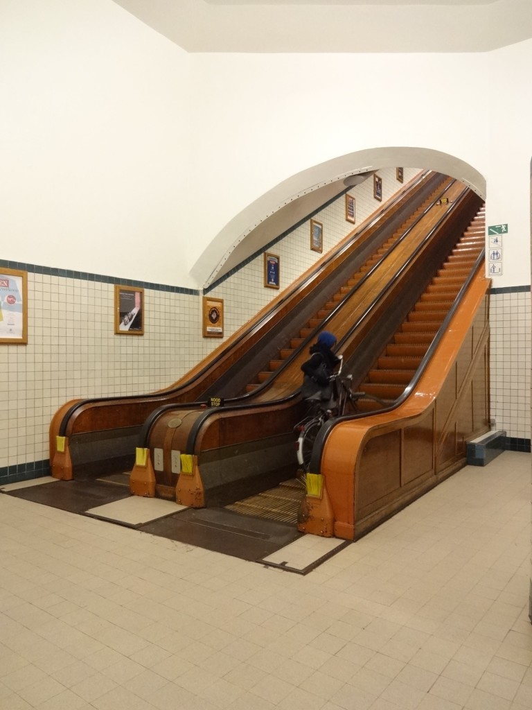 Antwerp, things to do in Antwerp, Art Deco architecture, Sint-Annatunnel, bottom of the escalator with cyclist