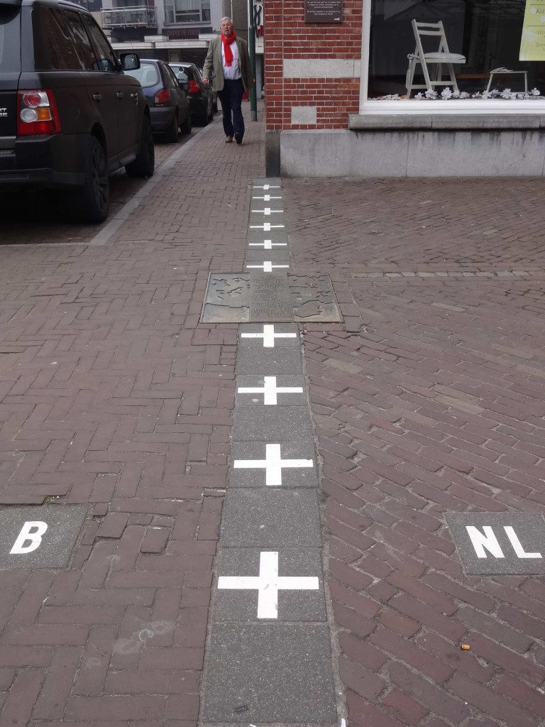 One of the many border lines found in and around the town of Baarle, officially marking out Belgian and Dutch territory
