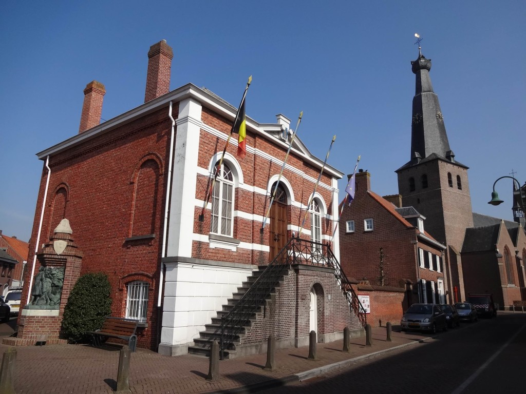 Heme House in Baarle Hertog near Saint Remigius Belgian church; once a Belgian town house now a proud Belgian National Monument. A bronze sculpture at the side of the building is in memory of three Baarle Hertog inhabitants who were executed by Nazis during the Second World War