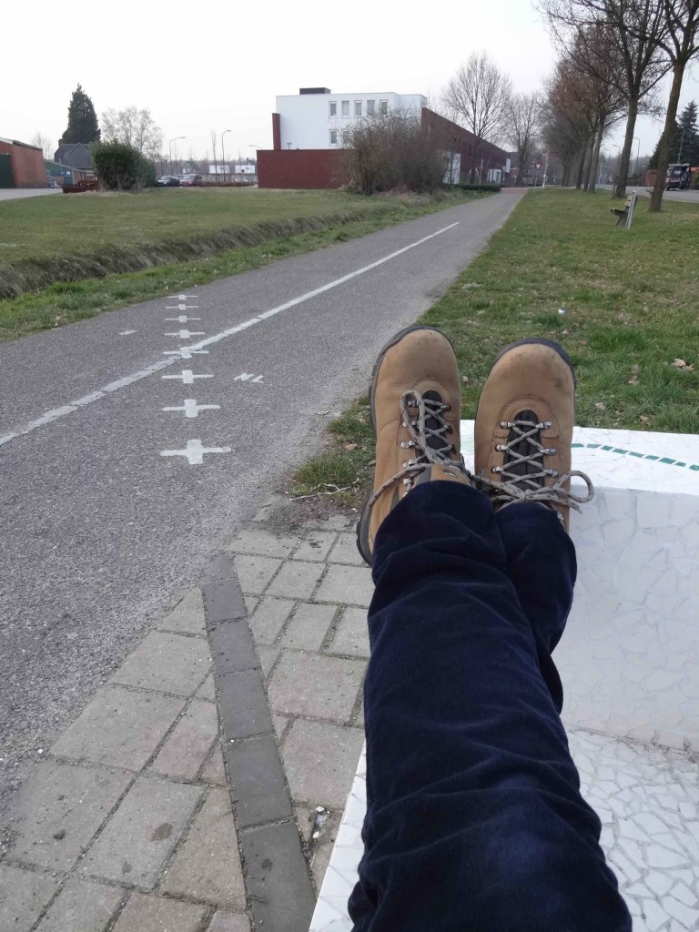 Not the most ladylike way to sit on a bench but I just couldn't resist straddling the border in this way