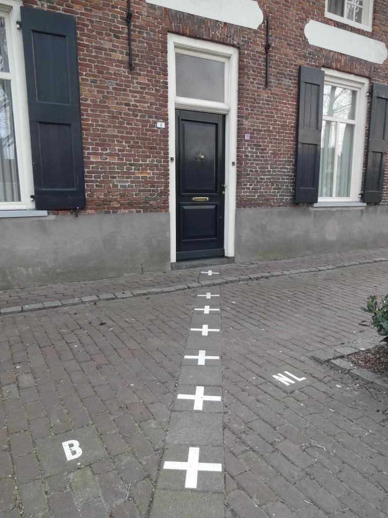 The front door is neither entirely in the Netherlands nor in Belgium, so the solution is ...