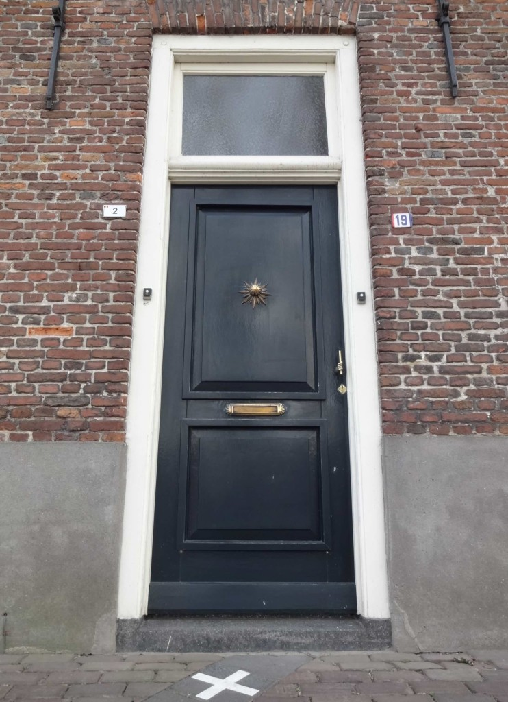 Two door numbers (Belgian number 2, Dutch number 19), two official addresses and even two door bells ... so I guess two annual property tax bills as well