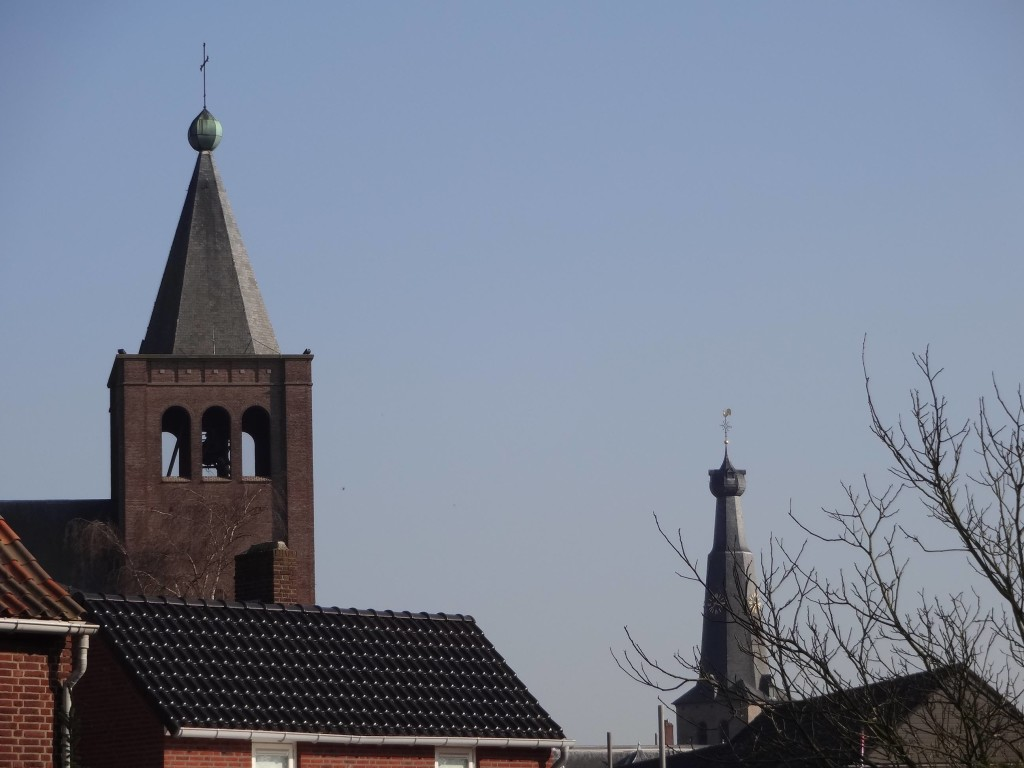 The spires of Baarle's Dutch and Belgian churches indicating how close they are to each other