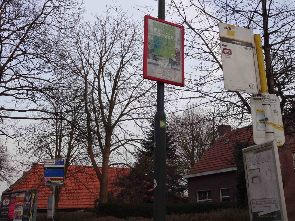 A Dutch bus stop (bottom left) and a Belgian bus stop (top right) with a poster in the middle advertising an event either nation can attend
