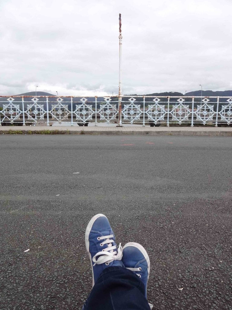 'Lollygagging' on the French-Spanish border (marked by the pole) along the historic Santiago Frontier Bridge between Hendaya (France) and Irun (Spain). My left foot here is in Spain, my right foot is in France, but all of me is in the Basque region