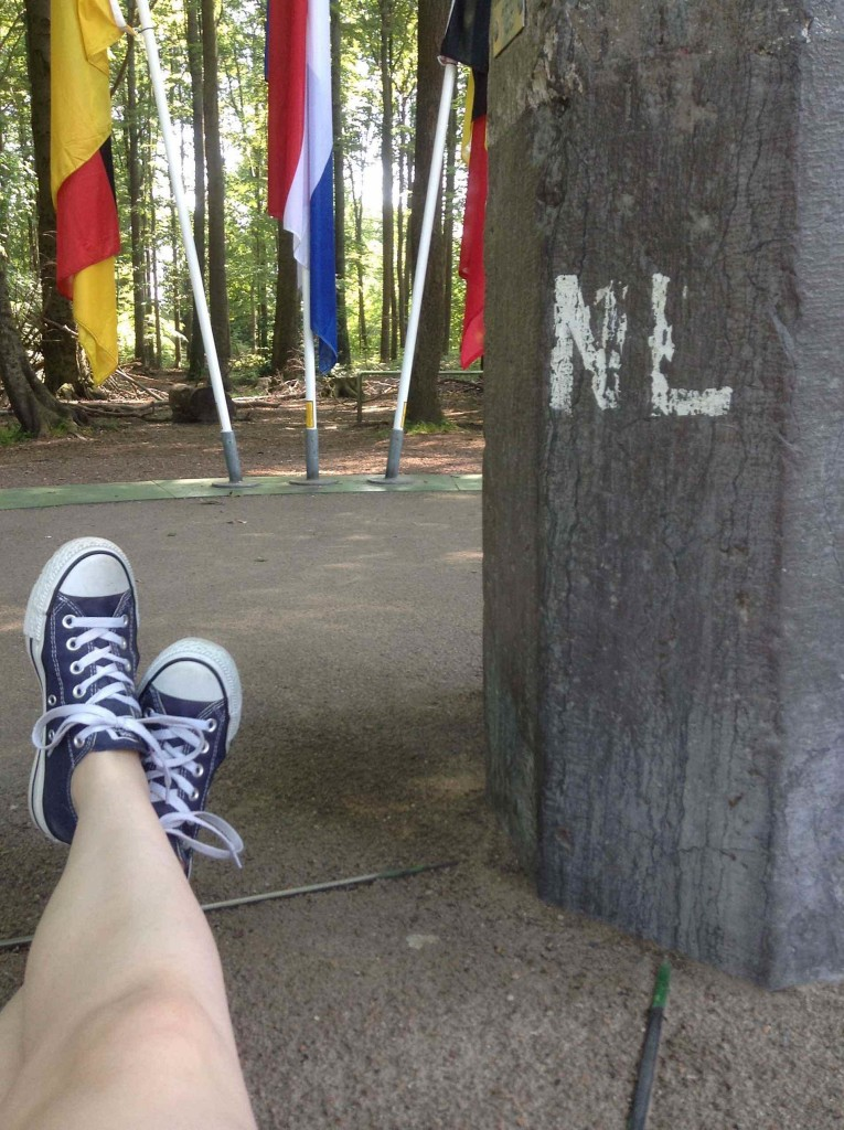 Legs rather than hands across nations. Feet in Germany, knees in the Netherlands, camera in Belgium