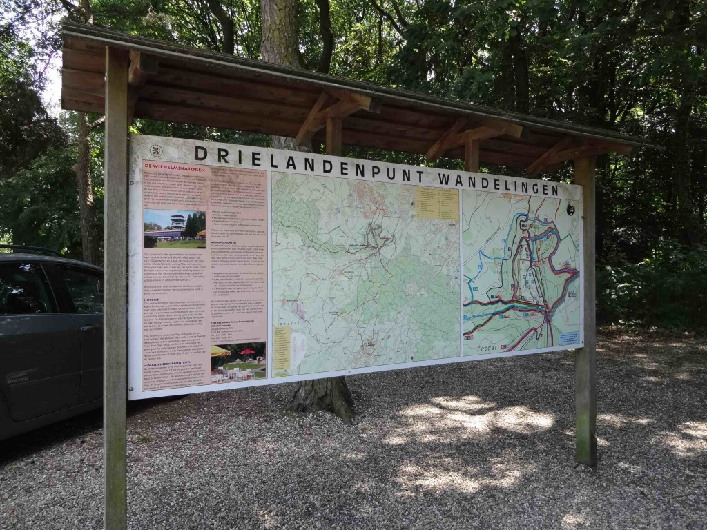 Signs for the Drielandenpunt only seem to become more noticeable once inside the forest it is found in