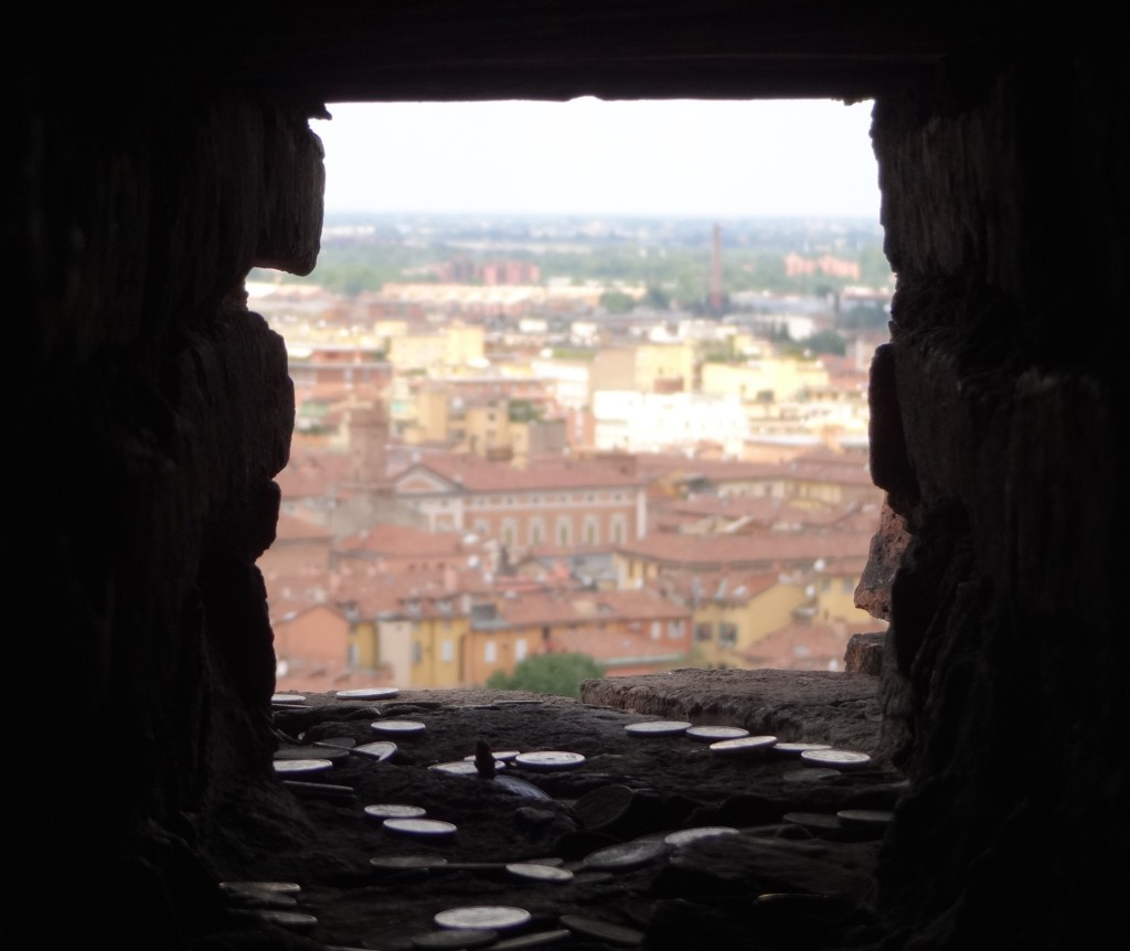 This is not actually a window but a hole that previously held a joist in place for floors no longer present inside the tower. It is now a place where superstitious tourists with good aim, throw unwanted change from the stairway