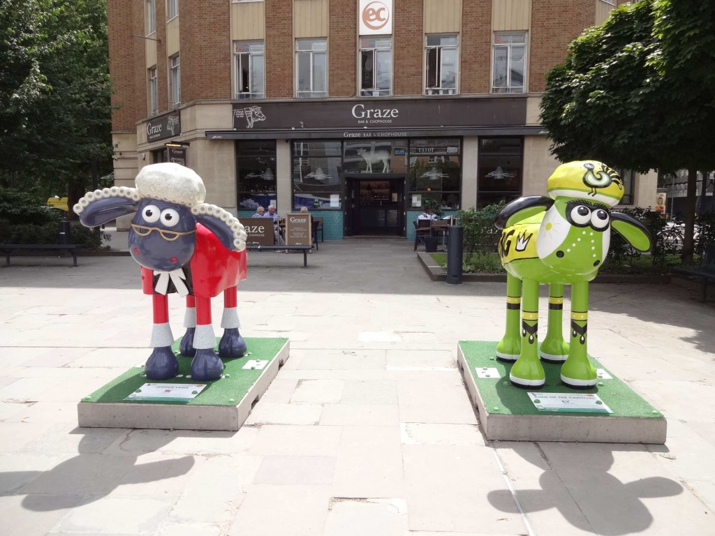 Clearly someone's idea of a joke placing these two in front of Graze's Chophouse. No wonder they look so sheepish