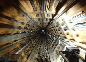 Brussels Atomium, speeding through lift shaft creating 2001 A Space Odyssey effect