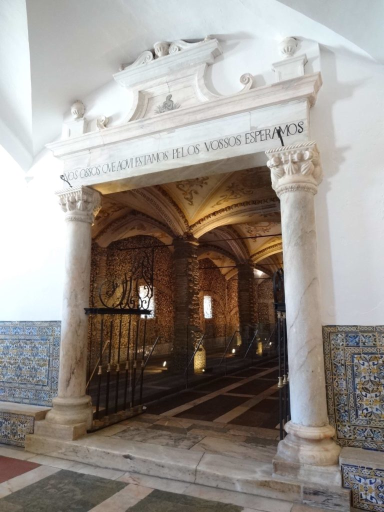 "The inscription above the entrance to the 'Capela dos Ossos' translates as ""We bones that are here, we are waiting for yours"". Hopefully the wait for mine will be long"