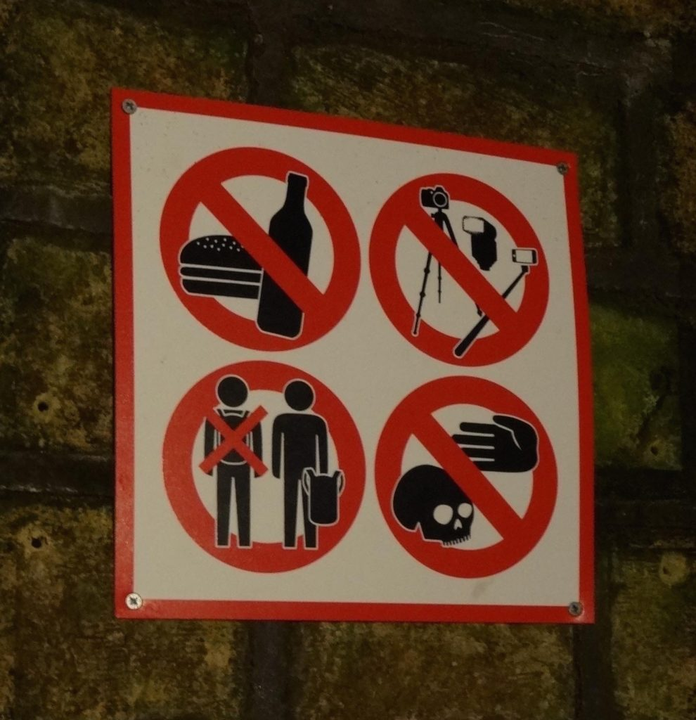 More contemporary signs are displayed by the entrance to each ossuary asking visitors to be respectful too: specifically 'no eating', 'no selfies' and 'no karate-chopping the skulls'