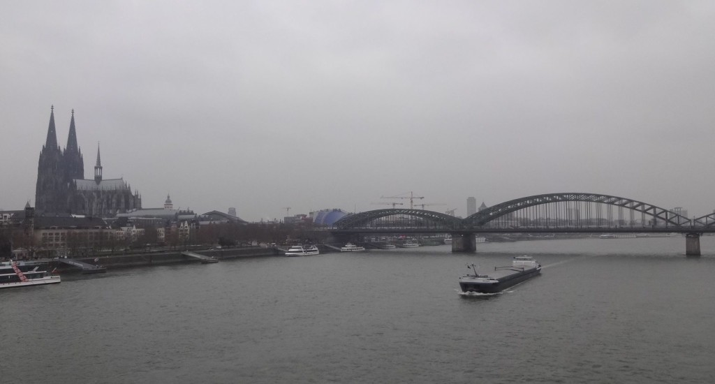 The skyline of Cologne. The city's famous Hohenzollern bridge crossing the Rhine and the iconic two towers of the Dom (left)